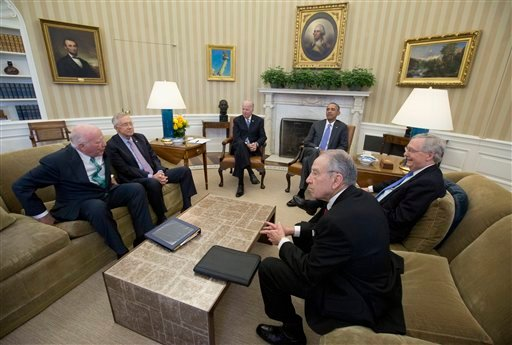 President Barack Obama meets with, from left, the Senate Judiciary Committee's ranking member Sen. Patrick Leahy, D-Vt., Senate Minority Leader Sen. Harry Reid of Nev., Vice President Joe Biden, the president, Senate Majority Leader Mitch McConnell of Ky.