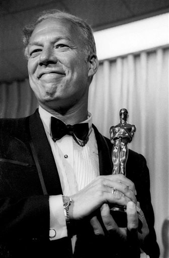 """In this April 10, 1968, file photo, George Kennedy poses with his Oscar in Santa Monica, Calif, after winning best supporting actor for """"Cool Hand Luke."""""""