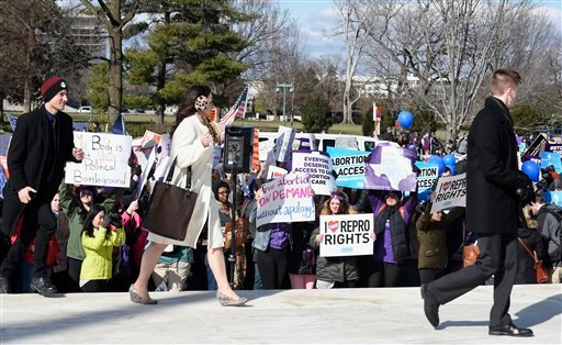 Members of the public arrive to visit the Supreme Court in Washington, Wednesday, March 2, 2016, as anti-abortion and pro-abortion rights protesters rally outside the court in. The abortion debate is returning to the Supreme Court in the midst of a raucou