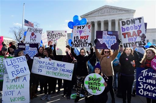 Pro-abortion rights protesters rally outside the Supreme Court in Washington, Wednesday, March 2, 2016. The abortion debate is returning to the Supreme Court in the midst of a raucous presidential campaign and less than three weeks after Justice Antonin S