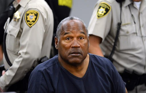 FILE - In this May 14, 2013, file photo, O.J. Simpson sits during a break on the second day of an evidentiary hearing in Clark County District Court in Las Vegas.