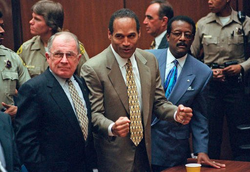 Oct. 3, 1995 file photo: O.J. Simpson reacts as he is found not guilty of murdering his ex-wife Nicole Brown and her friend Ron Goldman. (Myung J. Chun/Daily News via AP, Pool)