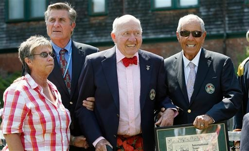 In this July 12, 2014, file photo, tennis Hall of Famers, from left, Rosie Casals, Charlie Pasarell, Bud Collins and Nick Bollettieri are shown during induction ceremonies at the International Tennis Hall of Fame in Newport, R.I.