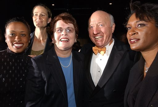 In this Nov. 23, 2002, file photo, tennis commentator Bud Collins, second from right, poses with tennis players, from left, Chanda Rubin, Pam Shriver, Billie Jean King and Zina Garrison at a reception in Boston.