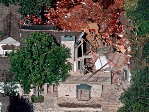 FILE: Crews demolish the former home of O.J. Simpson, Wednesday, July 29, 1998, in the Brentwood area of Los Angeles.