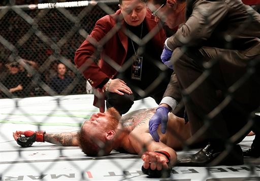 Conor McGregor recovers shortly after a second round-submission to Nate Diaz during their UFC 196 welterweight mixed martial arts match, Saturday, March 5, 2016, in Las Vegas. (AP Photo/Eric Jamison)