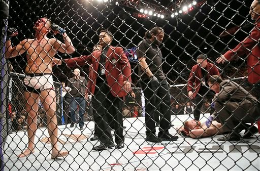 Nate Diaz, left, celebrates his second-round submission victory over Conor McGregor during their UFC 196 welterweight mixed martial arts match Saturday, March 5, 2016, in Las Vegas. (AP Photo/Eric Jamison)