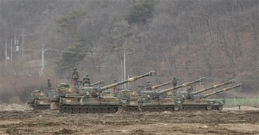 "South Korean army soldiers stand on their K-55 self-propelled howitzers during an annual exercise in Paju, near the border with North Korea, Monday, March 7, 2016. North Korea on Monday issued its latest belligerent threat, warning of an indiscriminate ""p"
