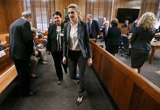 Sportscaster and television host Erin Andrews, center, leaves the courtroom after her lawsuit was given over to the jury Monday, March 7, 2016, in Nashville, Tenn. Andrews has filed a $75 million lawsuit against the franchise owner and manager of a luxury