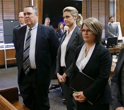 Sportscaster and television host Erin Andrews, center, stands with attorney Scott Carr, left, as the jury enters the courtroom Monday, March 7, 2016, in Nashville, Tenn. Andrews' $75 million lawsuit against the franchise owner and manager of a luxury hote