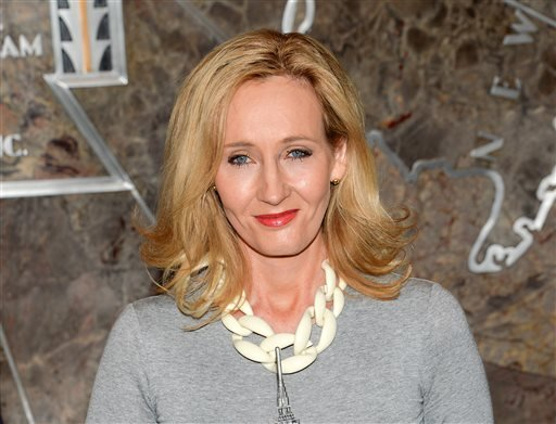 "FILE - In this April 9, 2015 file photo, ""Harry Potter"" author J.K. Rowling lights the Empire State Building to mark the launch of her non-profit children's organization Lumos, in New York."