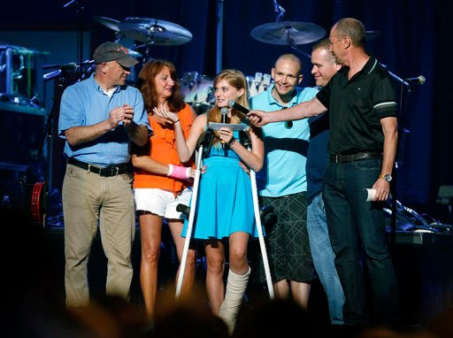 In this May 30, 2013 file photo, Boston Marathon bombing survivor Victoria McGrath, center, thanks people who helped her after she was injured in the bombing, during the Boston Strong Concert: An Evening of Support and Celebration.