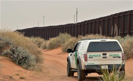 U.S. Border Patrol agent drives near the U.S.-Mexico border fence in Santa Teresa, N.M. (AP Photo/Russell Contreras)