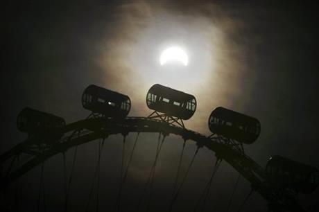 A partial solar eclipse is seen behind passenger capsules of the Singapore Flyer Wednesday, March 9, 2016, in Singapore. The last eclipse happened in Singapore in January 2009 and the next solar eclipse, an annular one, will occur on December 26, 2019. AP