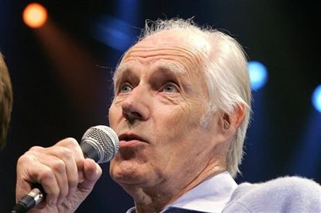"""In this May 24, 2006, file photo, Beatles producer Sir George Martin answers a question from the media after the sneak preview of a new Beatles-themed Cirque du Soleil show, """"Love,"""" in Las Vegas on Wednesday, May 24, 2006. (AP Photo/Jae C. Hong, File)"""