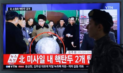 "A South Korean army soldier walks by a TV screen showing North Korean leader Kim Jong Un with superimposed letters that read: ""North Korea's nuclear warhead"" during a news program at Seoul Railway Station in Seoul, South Korea, Wednesday, March 9, 2016."