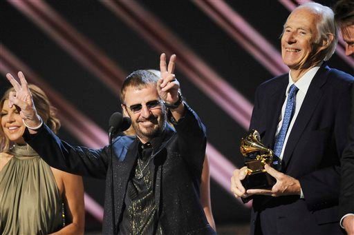 """FILE - In this Feb. 10, 2008, file photo, musician Ringo Starr, center, and Beatles producer Sir George Martin accept the best compilation soundtrack album award for """"Love"""" during the 50th annual Grammy awards held at the Staples Center in Los Angeles."""