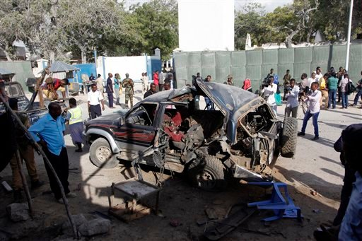 The wreckage of a car used for a suicide bombing sits outside a police academy in Mogadishu, Somalia, Wednesday, March 9, 2016. A Somali police official said three police officers and one civilian have been killed in a car bombing. Gen. Ali Hersi Barre sa