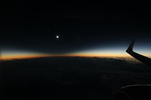 This photo provided by Dan McGlaun shows the full shadow of the moon during the total solar eclipse on Tuesday, March 8, 2016, as seen from an airplane over the North Pacific Ocean. So-called eclipse chasers boarded a special flight from Anchorage to Hono