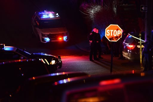 Police investigate the scene after a deadly shooting on Wednesday, March 9, 2016, in Wilkinsburg, Pa. Police say multiple people were killed in the shooting and several were injured in suburban Pittsburgh.