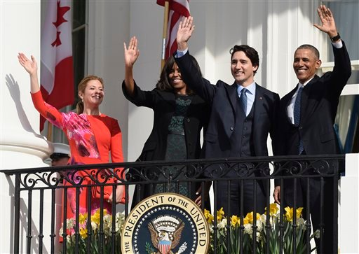 President Barack Obama, Canadian Prime Minister Justin Trudeau, first lady Michelle Obama and Sophie Gregoire Turdeau wave from the Truman Balcony during a state arrival ceremony on the South Lawn of White House in Washington, Thursday, March 10, 2016.