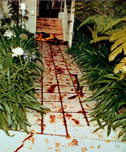 The body of Nicole Brown Simpson is seen where she was found on the bloodstained walkway of her Bundy Drive condominium as seen in this LAPD evidence photo.