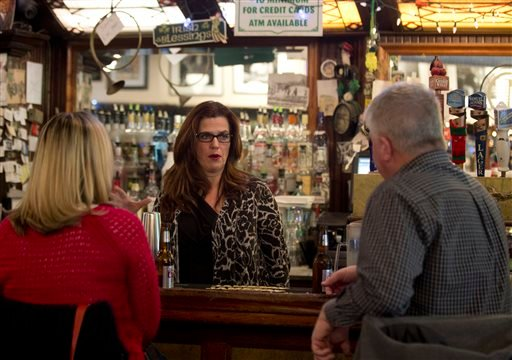 In this Thursday, Feb. 4, 2016, photo, Tess Collins talks to patrons at McGeary's Irish Pub in Albany, N.Y. (AP Photo/Mike Groll)