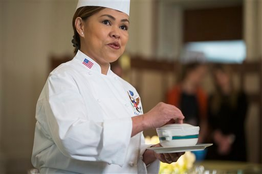 White House executive chef Cristeta Comerford speaks during a press preview ahead of the state dinner with Canadian Prime Minister Justin Trudeau, Wednesday, March 9, 2016, in the State Dining Room of the White House in Washington. (AP Photo/Evan Vucci)
