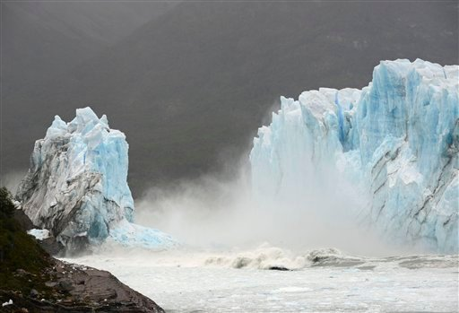 Mist rises from Lake Argentina, after the Perito Moreno Glacier's ice bridge collapsed into the lake at Los Glaciares National Park, near El Calafate, in Argentina's Patagonia region, Thursday, March 10, 2016. The massive natural monument in the province