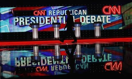 A CNN staffer walks across the stage where the Republican presidential debate sponsored by CNN, Salem Media Group and the Washington Times will take place, at the University of Miami, Thursday, March 10, 2016, in Coral Gables, Fla. (AP Photo/Marta Lavandi