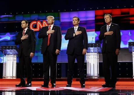 Republican presidential candidates, Sen. Marco Rubio, R-Fla., from left, Donald Trump, Sen. Ted Cruz, R-Texas, and Ohio Gov. John Kasich, stand together during the signing of the National Anthem, before the start of the Republican presidential debate spon