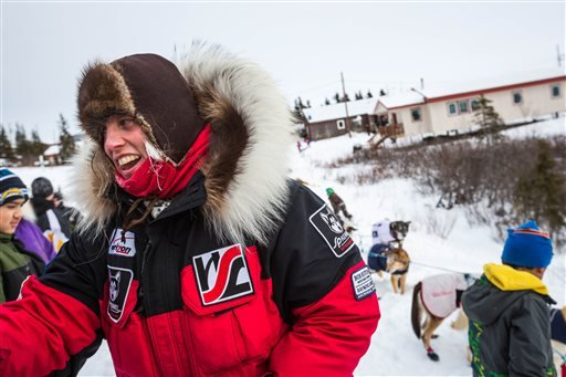 FILE - In this March 16, 2015 file photo, Aliy Zirkle arrives at the Koyuk, Alaska, checkpoint during the Iditarod Trail Sled Dog Race.
