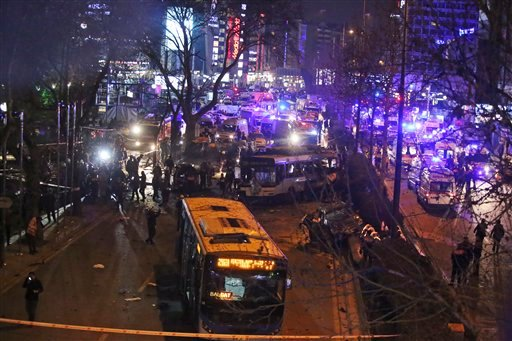 Members of emergency services work at the scene of an explosion in Ankara, Turkey, Sunday, March 13, 2016. A television channel said the bomb exploded close to bus stops near a park at Ankara's main square, Kizilay. The news channel said the explosion occ