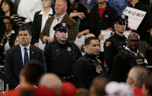 The Secret Service and the Cleveland Police keep a close watch as Republican presidential candidate Donald Trump speaks at a campaign rally at the I-X Center Saturday, March 12, 2016, in Cleveland. (AP Photo/Tony Dejak)