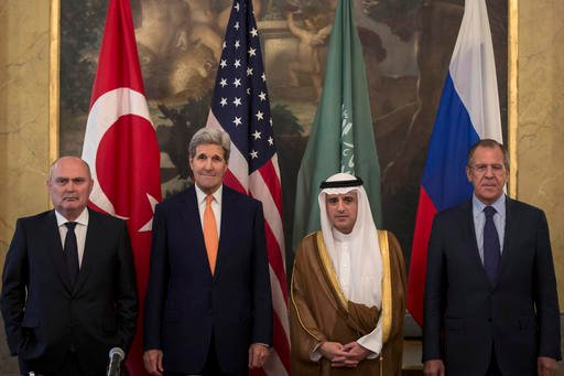 In this file photo taken on Friday, Oct. 23, 2015, From left, Turkey's Minister of Foreign Affairs, Feridun Sinirlioglu, U.S. Secretary of State John Kerry, Saudi Arabia's Minister of Foreign Affairs Arabia Adel al-Jubeir and Russia's Foreign Minister Se
