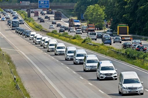 In this June 10, 2015 file picture, a convoy of hearses drives on the highway in Duisburg, Germany. taking home victims who died in the Germanwings plane crash in the French Alps in March 2015. France's air accident investigation agency releases report i