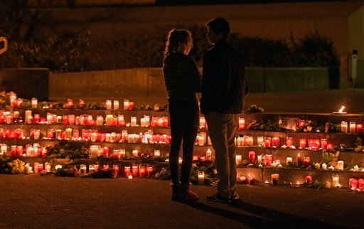 In this March 24, 2015 file picture students stand near candles in front of the Joseph-Koenig Gymnasium in Haltern, western Germany. .Students of this school were among the victims of of the Germanwings plane that crashed in the French Alps killing all 15