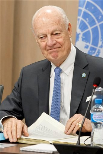 UN Special Envoy of the Secretary-General for Syria Staffan de Mistura, gestures prior a new round of negotiations between the Syrian chief negotiator Bashar al-Jaafari , Ambassador of the Permanent Representative Mission of t Syria to the UN in New York,