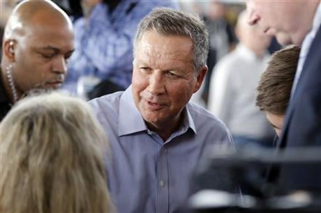 Republican presidential candidate, Ohio Gov. John Kasich meets with attendees during a campaign stop on Monday, March 14, 2016, at the MAPS Air Museum in North Canton, Ohio. (AP Photo/Matt Rourke)