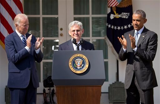 Federal appeals court judge Merrick Garland, receives applauds from President Barack Obama and Vice President Joe Biden as he is introduced as Obama's nominee for the Supreme Court.