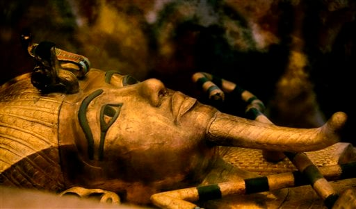 FILE - In this Thursday, Nov. 5, 2015 file photo, one of Egypt's famed King Tutankhamun's golden sarcophagus is displayed at his tomb in a glass case at the Valley of the Kings in Luxor.