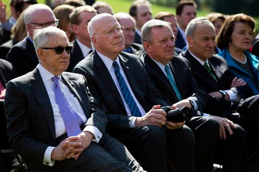 From left, Senate Minority Leader Sen. Harry Reid, D-Nev., Sen. Patrick Leahy, D-Vt., Sen. Dick Durbin, D-Ill., Sen. Chuck Schumer, D-N.Y., and Sen. Dianne Feinstein, D-Calif., watch as President Barack Obama nominates Federal appeals court judge Merrick.