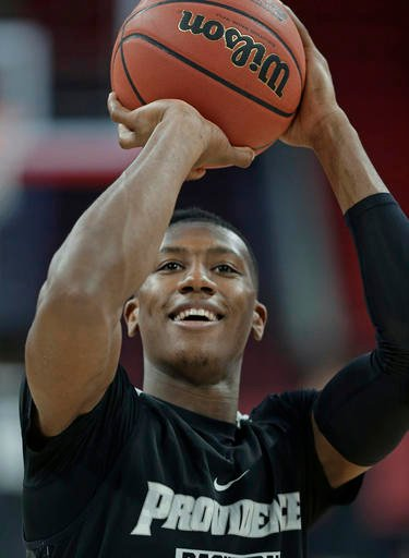 Providence's Kris Dunn shoots during practice for a first-round men's college basketball game in the NCAA Tournament in Raleigh, N.C., Wednesday, March 16, 2016.