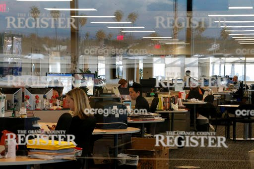 This Dec. 27, 2012 file photo shows the newsroom of the Orange County Register in Santa Ana, Calif. Tribune Publishing said Thursday, March 17, it placed the winning bid at an auction of the Southern California suburban newspapers owned by bankrupt Freed