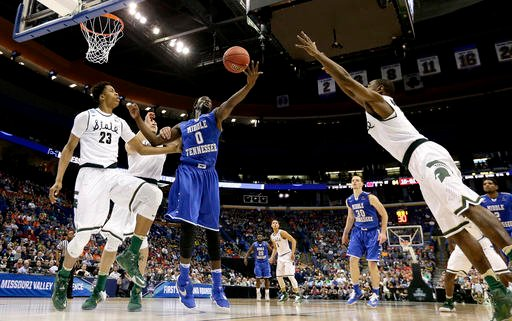 Middle Tennessee's Darnell Harris (0) beats Michigan State's Deyonta Davis (23) to a rebound during the second half of a first-round men's college basketball game in the NCAA Tournament March 18, 2016, in St. Louis. (AP Photo/Charlie Riedel)