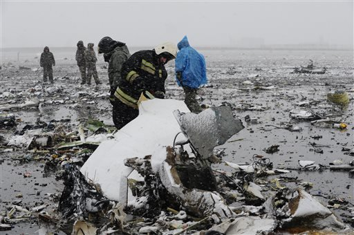 Russian Emergency Ministry employees investigate the wreckage of a crashed plane at the Rostov-on-Don airport, about 950 kilometers (600 miles) south of Moscow, Russia Saturday, March 19, 2016.