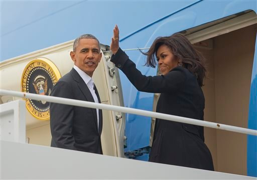President Barack Obama first lady Michelle Obama board Air Force One, Sunday, March 20, 2016, at Andrews Air Force Base, Md. Obama and his family are traveling to Cuba, the first U.S. president to visit the island in nearly 90 years. (AP Photo/Pablo Marti