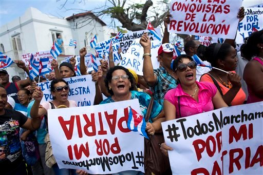 Government supporters stage a counter-protest to one held by Ladies in White, a dissident women's group that calls for the release of political prisoners, near the dissident group's weekly protest in Havana, Cuba, Sunday, March 20, 2016. U.S. President Ba
