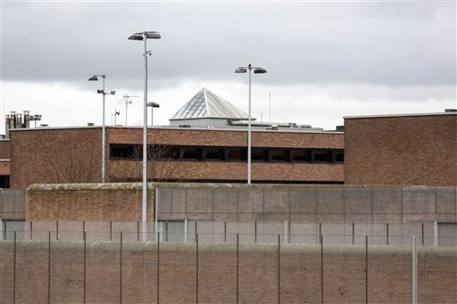 "The federal penitentiary in Bruges, Belgium, where a convoy thought to be carrying captured fugitive Salah Abdeslam arrived on Saturday, March 19, 2016 . Abdeslam was charged with ""terrorist murder"" on Saturday by Belgian authorities and his lawyer vowed"