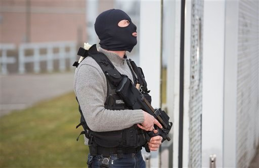 A special forces police officer awaits a convoy and ambulance thought to be carrying captured fugitive Salah Abdeslam at the federal penitentary in Bruges, Belgium, on Saturday, March 19, 2016. Salah Abdeslam, the top suspect in last year's Paris attacks,